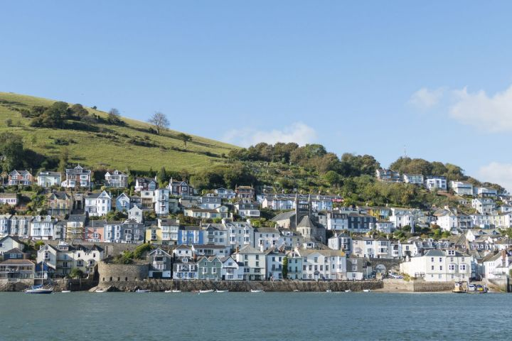 Scene of riverside properties in Devon